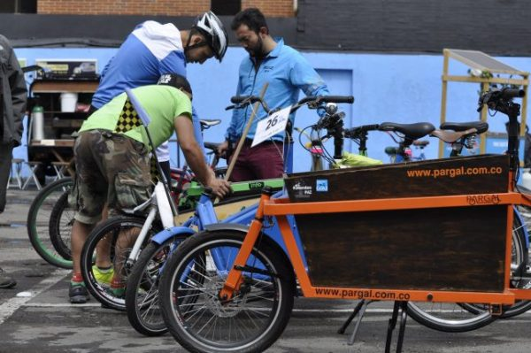 Experts from Despacio, an EcoLogistics partner (see below), inspect a cargo bike in Bogotá.