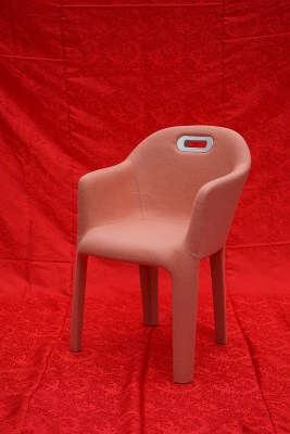 pink chair and red background