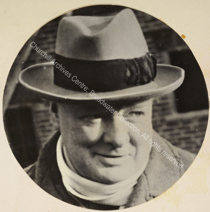 Photo of WSC smiling and wearing a hat and scarf.