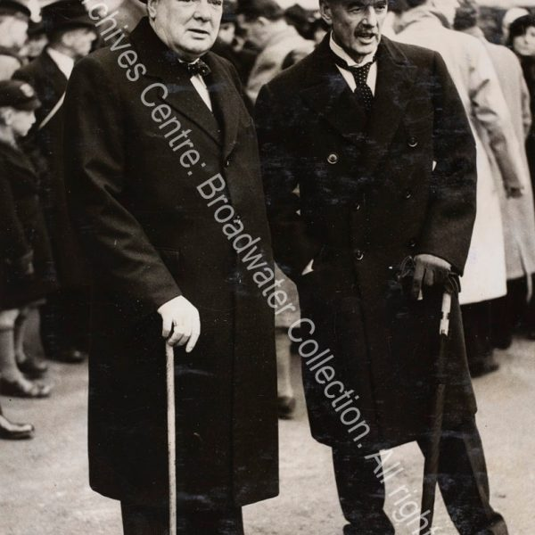 Photo shows WSC and Neville Chamberlain standing together
