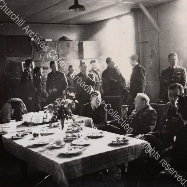 Photo shows WSC sitting ?in the mess at RAF Manston