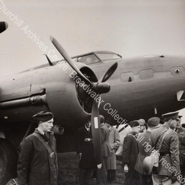 Photo shows WSC in the cockpit of an aeroplane.