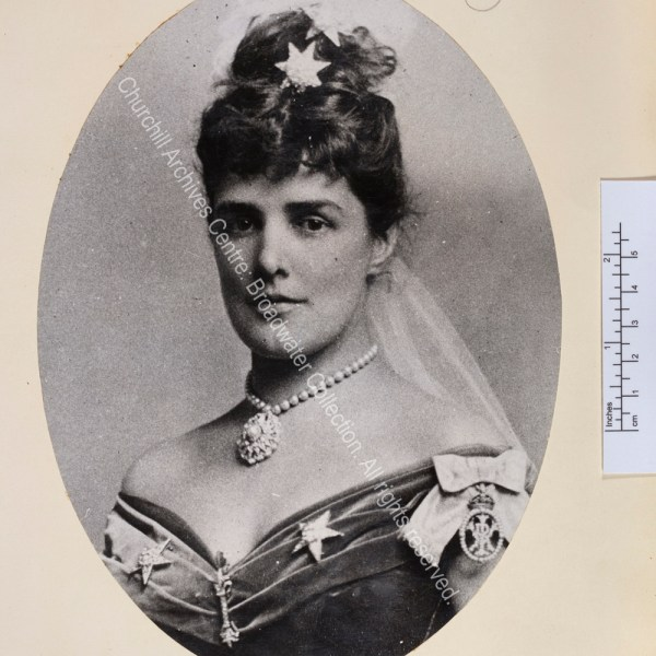 Oval portrait photograph showing Lady Randolph wearing evening dress with jewels in the shape of stars in her hair and on her dress.