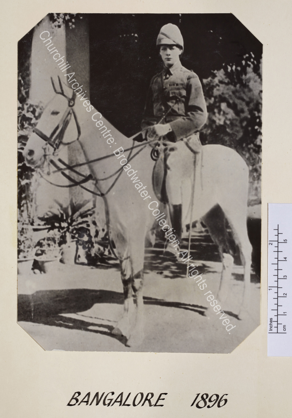 WSC mounted on a grey horse wearing cavalry uniform.