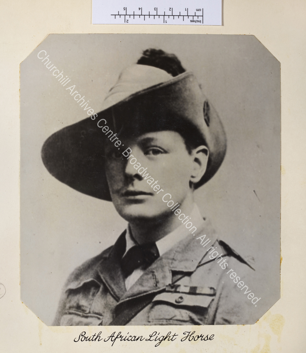 Head and shoulders portrait photograph of WSC with moustache wearing uniform and hat.