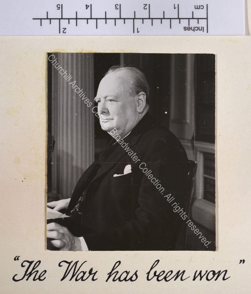 Photo of WSC in profile seated at a desk [in 10 Downing Street to make a broadcast to the nation].