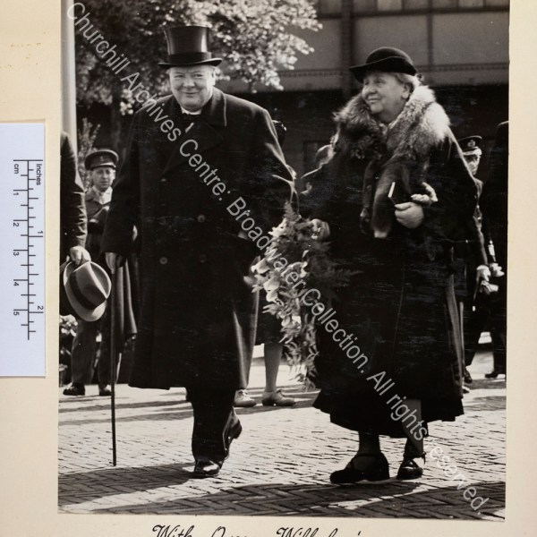 Photograph shows WSC and Queen Wilhelmina walking together