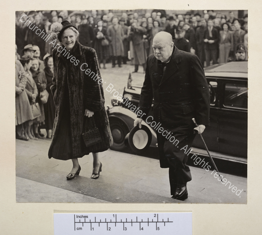 Photograph showing WSC and CSC walking up wide steps. CSC is wearing a fur coat.