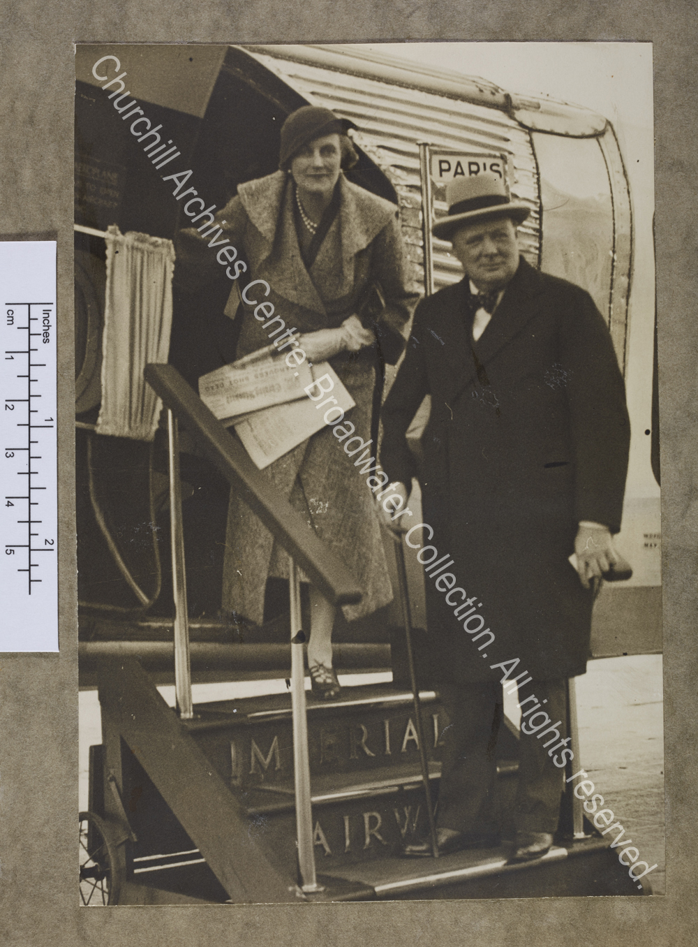 Photograph of WSC and CSC boarding an Imperial Airways plane at Croydon [Surrey] for Paris [France