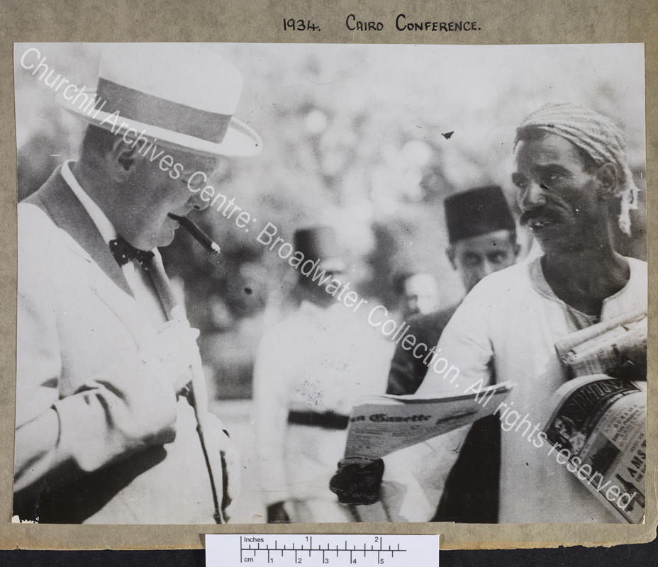Half length photograph of WSC with an Arab newspaper seller in Cairo [Egypt]