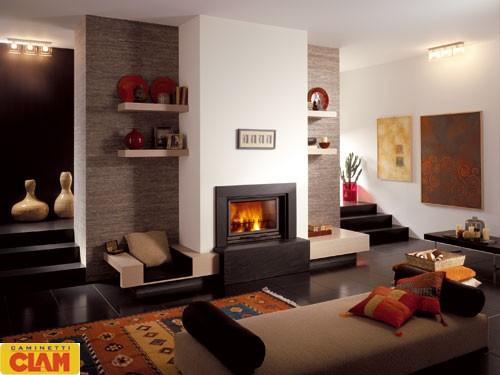 La soluzione in foto rappresenta la più romantica e moderna parete attrezzata in cartongesso con camino e tv: Living Area And Kitchen Interior Design Designed By Nouveau Atelier Design Gopillar