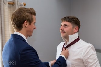 Alex getting his tie put on by best man MAtt
