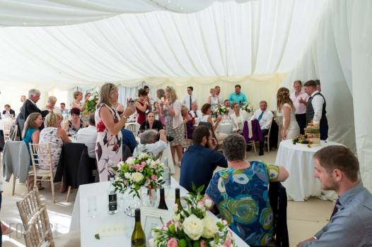 guest watching the wedding cake being cut