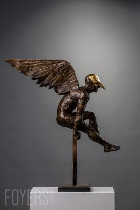 Leap of Faith has been based on a drawing by Catherine de Rosa. The wings were made from paper and then dipped in wax giving a clean line to the vaulting figure. He is wearing a Venetian bird mask which has been gold leafed. Many of the early images of Icarus portray him masked.