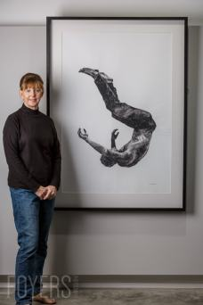 Kate Denton standing with painting