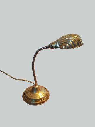 A flexible brass desk lamp