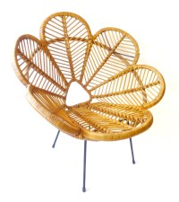 A wicker bucket chair designed in the form of flower ...