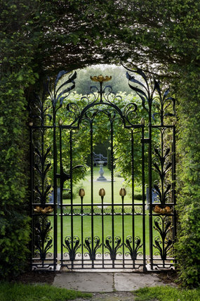View through a decorative wroughtiron gate into the