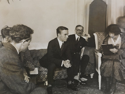 Charlie Chaplin being interviewed at the Ritz Hotel