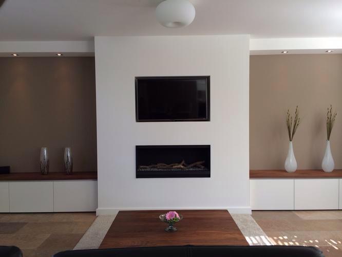Ombouw  koof  tussenmuur voor tv en elektrische haard