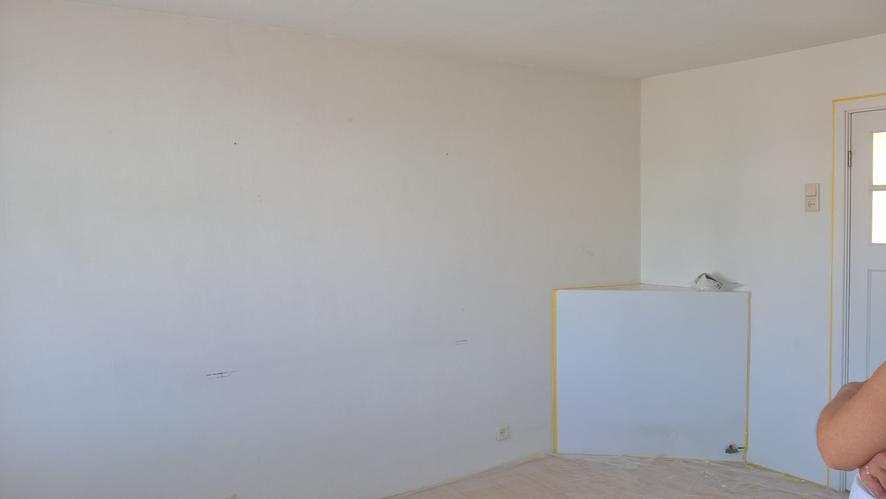 Geluidsisolatie tussenmuur slaapkamer met schouw in hoek