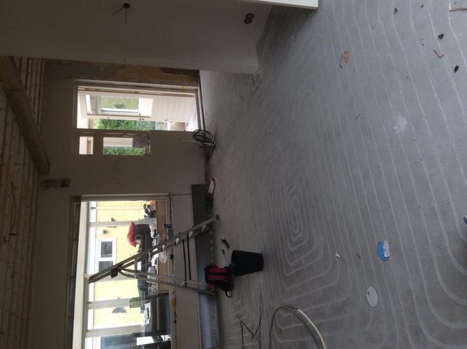 Betegelen woonkamer en hal  Werkspot