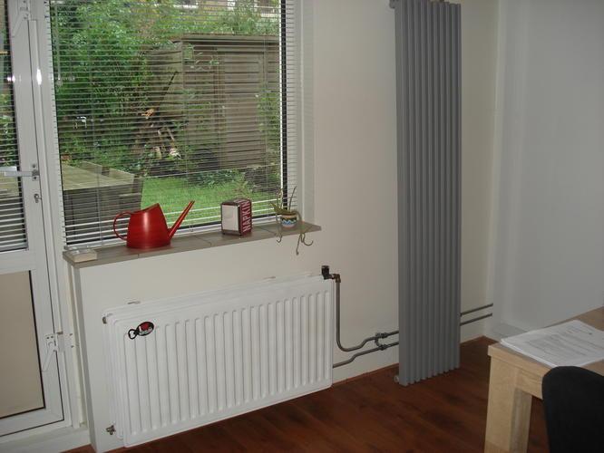 ophangen en aansluiten designradiator  Werkspot