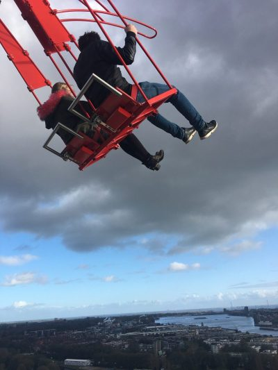 A couple on the A'DAM Lookout swing in Amsterdam