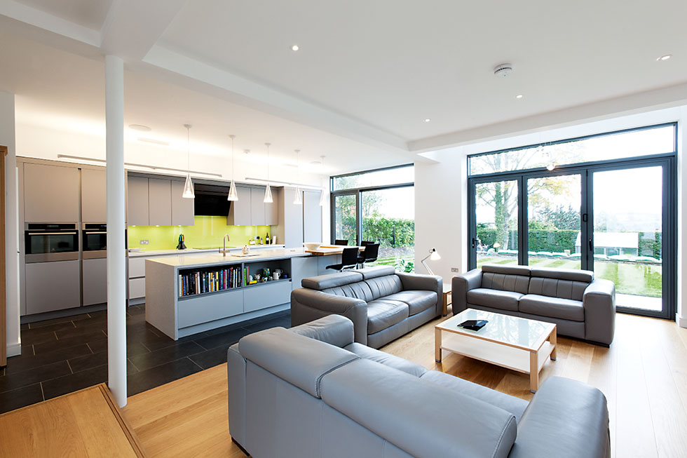 living room open plan designs single chairs for how to get it right homebuilding renovating space zoned with flooring