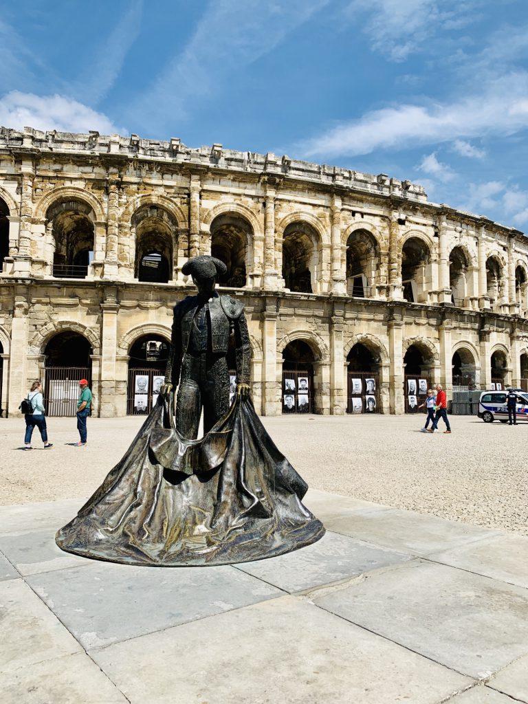 Nemis Amphitheatre with statue of a matador