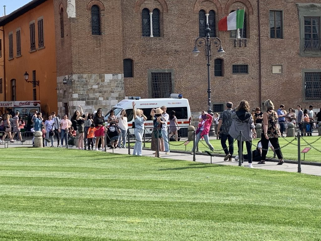 Other people posing with the leaning tower of pisa