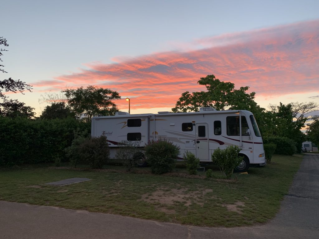 RV on pitch at sunset at Le Village de Meunier