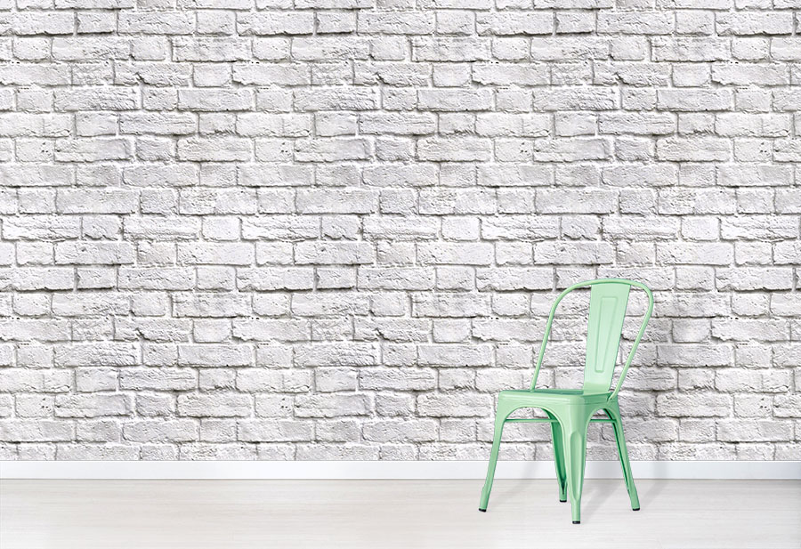 White brick Wall Wallpaper Mural in situ with green chair