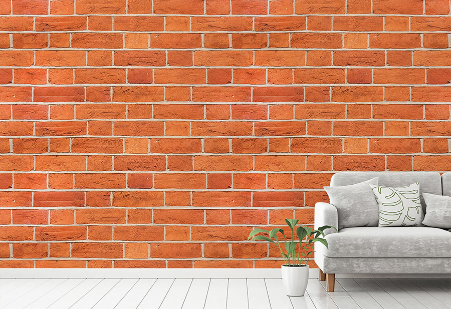 Red Brick Wall Mural in situ with sofa and plant