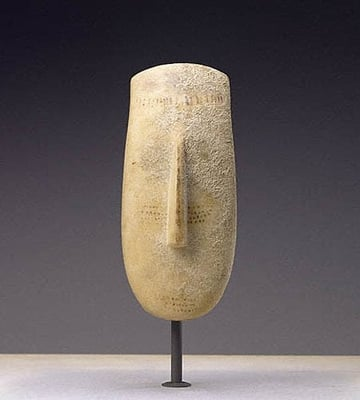 A large Cycladic marble head, dated circa 2600-2500 BC. Sold by the Merrin Gallery to the J. Paul Getty Museum