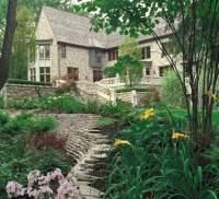 English garden wall in backyard landscape design. Stone ...