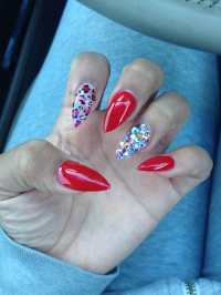Red nails, cheetah print and Swarovski crystals... Done by