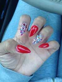Red nails, cheetah print and Swarovski crystals... Done by ...
