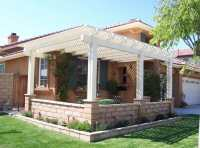 Lattice style patio cover in front yard. | Yelp
