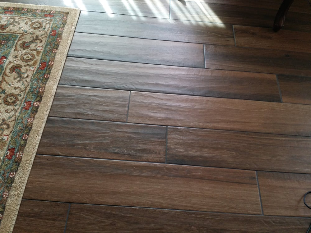Faux wood grain porcelain tile planks with shadow like