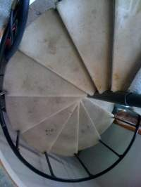 Normal wear and tear on this spiral staircase. - Yelp
