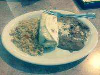 The small El Monterey style burrito I ordered. It was only ...