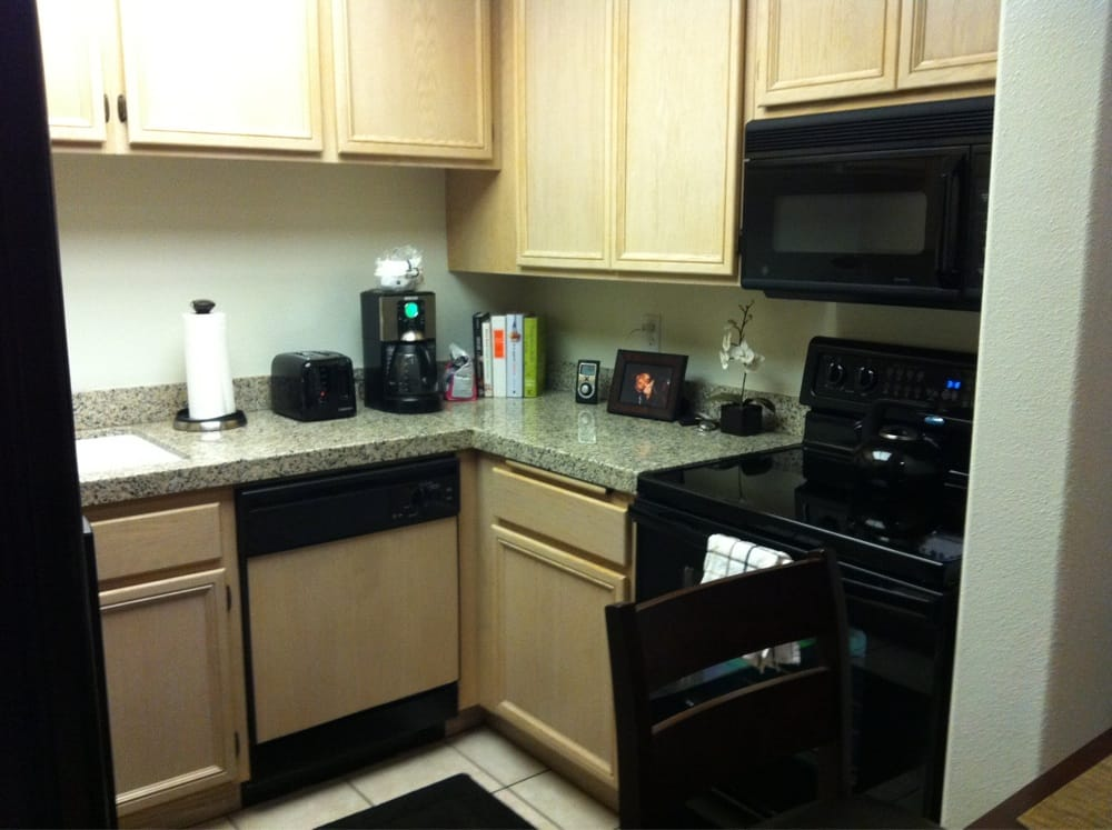 Nice granite and black appliances in kitchen  Yelp