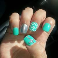 Gel nails with chevron design and rhinestone cross. I have ...