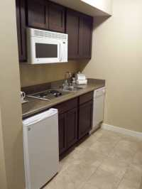 Kitchenette with mini refrigerator, sink, stove, microwave ...