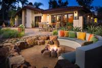 Sunken patio with decomposed granite and boulders creating ...