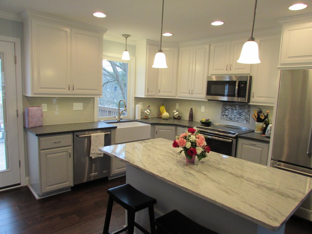 Kitchen remodel in Urbana MD with a farm sink and casement window with a view By Talon