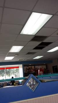 Missing ceiling tiles, trash cans placed under them. - Yelp
