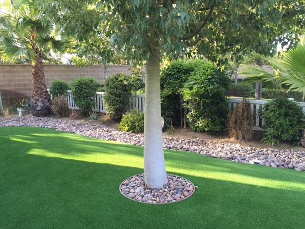 synthetic turf and river rock