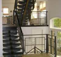 Wrought iron staircase with wood treads and contemporary ...